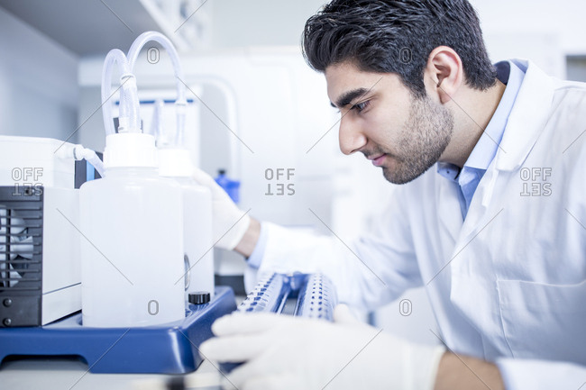 Lab assistant using equipment