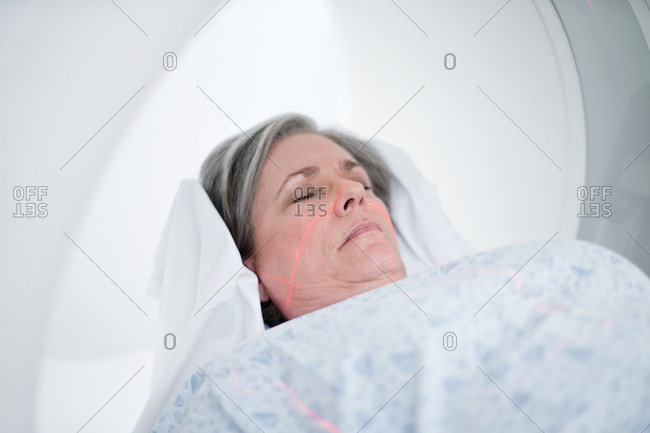 Female patient in MRI scanner