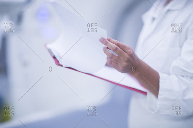 Hospital radiologist checking notes