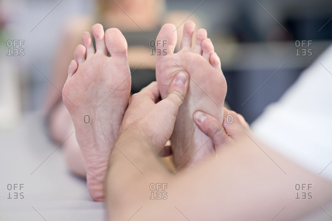 Person massaging woman's feet