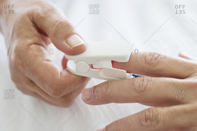 Nurse applying pulse oximeter - Offset