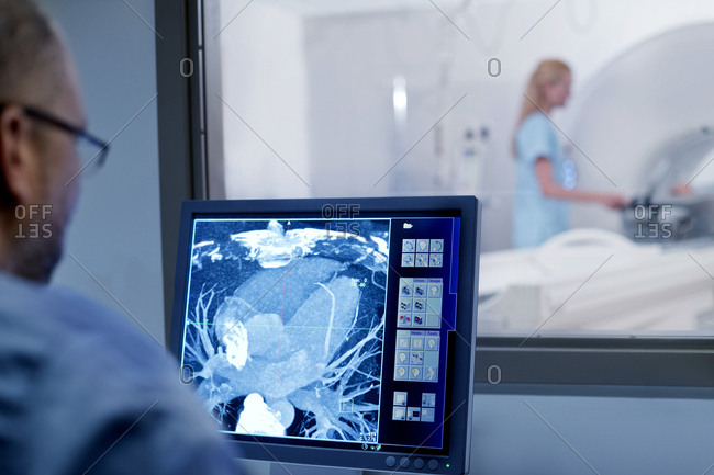 Doctor looking at MRI scan on monitor