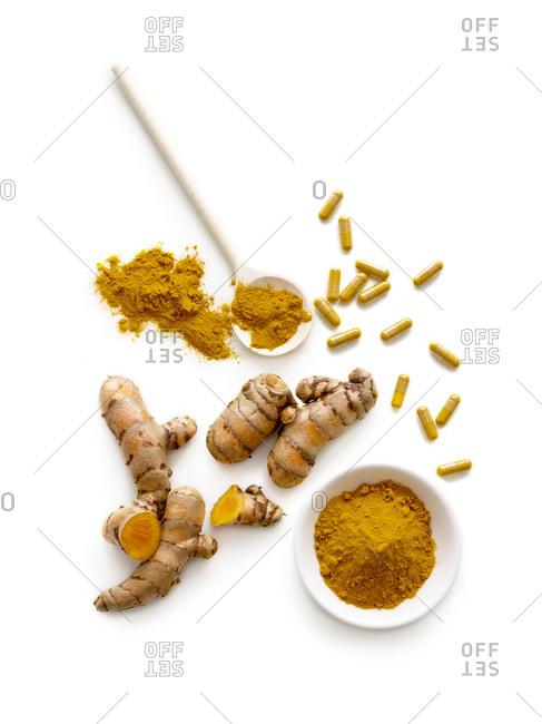 Turmeric root, powder and capsules