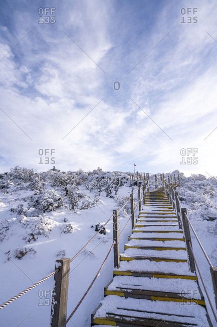 Snowy steps on a hiking train in South Korea