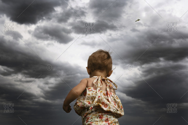 Little Girl Looking Into Stormy Sky Stock Images Page Everypixel