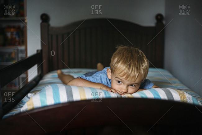Little boy lying in bed awake