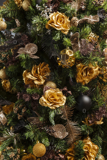 Christmas tree with gold roses and bulbs