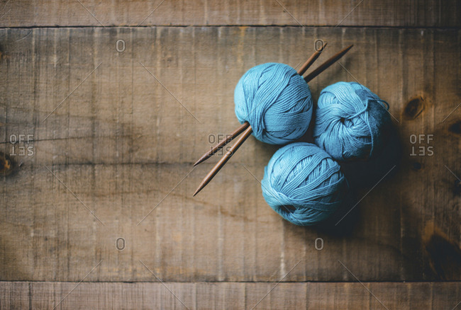 Blue ball of wools on table