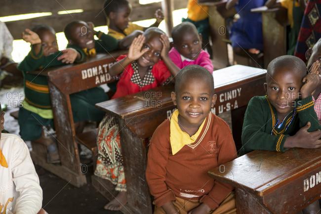 Children sitting at desks in school