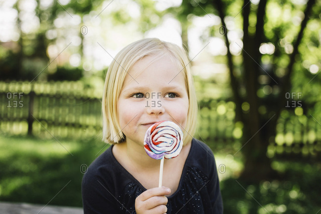 Close-up of girl looking away while eating lollipop