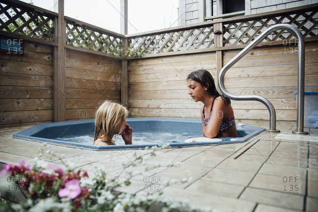 Girls in hot tub at tourist resort
