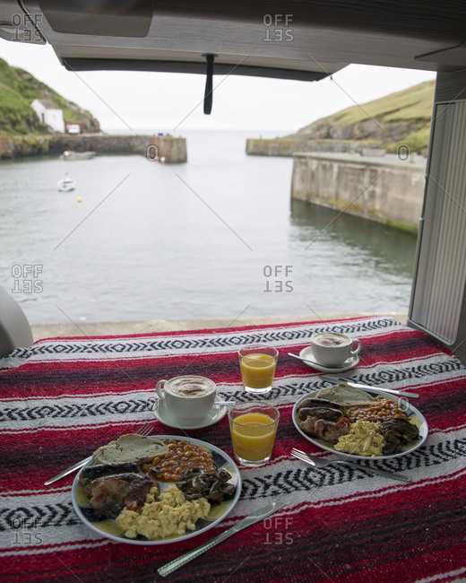 High angle view of food served in motor home against sea