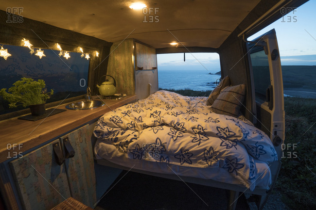 Interior of illuminated motor home at dusk