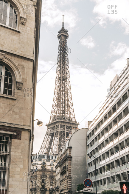 Low angle view of buildings against Eiffel tower