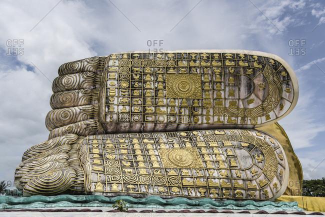 Low angle view of Mya Tha Lyaung Reclining Buddha against sky
