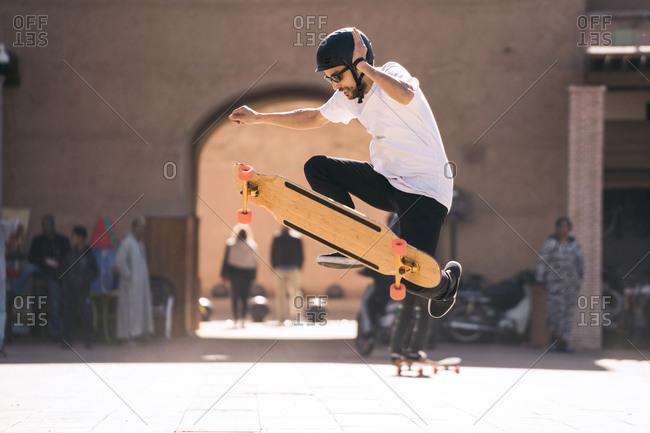 Man skateboarding during sunny day