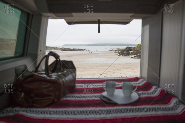 Scenic view of sea against cloudy sky seen through motor home