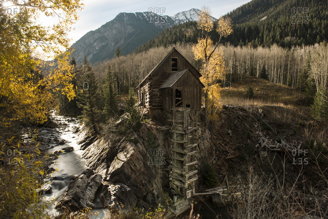Scenic view of Crystal Mill by river during autumn