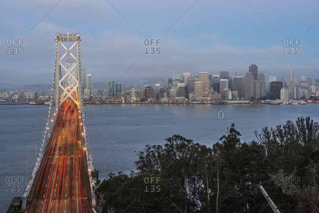 High angle view of light trails moving on Oakland Bay Bridge over treasure island in city
