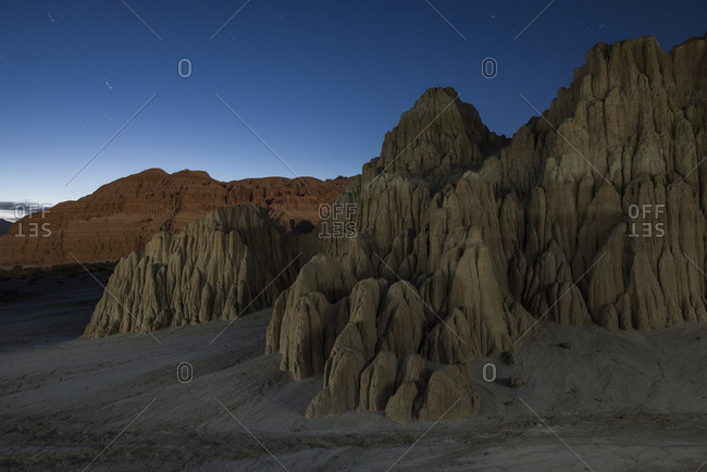 Scenic view of Cathedral Gorge State Park against blue sky at night
