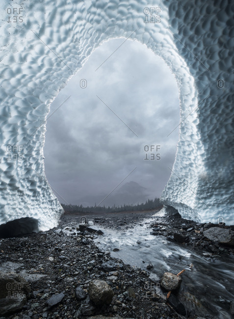 Cloudy sky seen through ice cave at North Cascades National Park