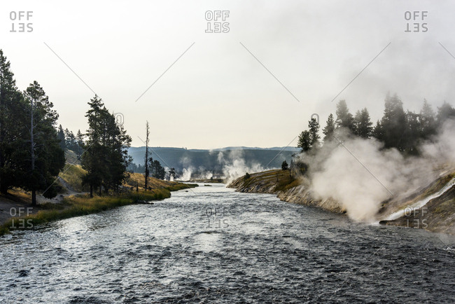 Scenic view of geyser against clear sky