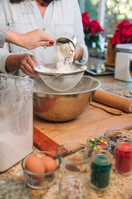 Woman baking holiday cookies in kitchen