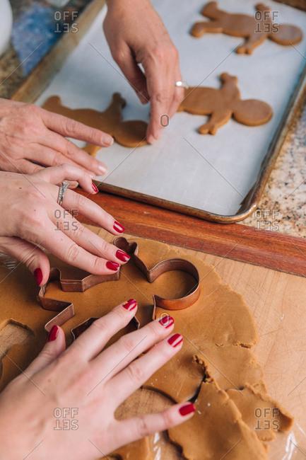 Women baking holiday cookies