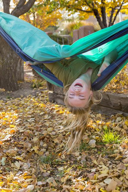 Girl playing in hammock