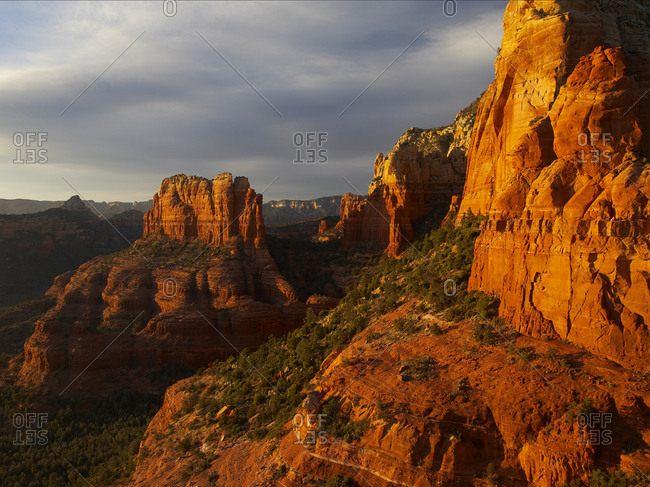 Sunset light illuminates rock formations in Red Rock-Secret Mountain Wilderness