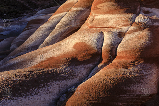 Abstract patterns of salt stains on red sandstone formations, on the Baja Peninsula at Puerto Gato