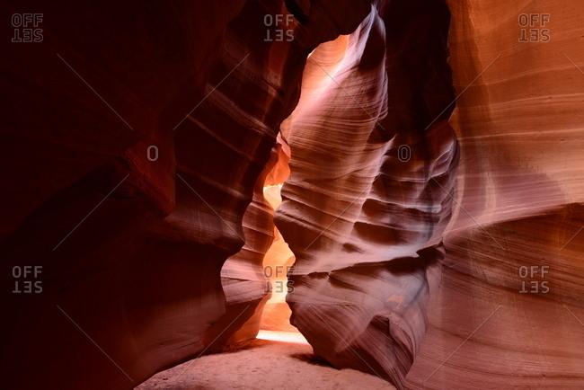 Sandstone slot canyon illuminated by reflected sunlight