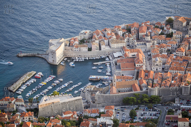 Dubrovnik's port and old city encircled by its historic ramparts from the top of the city's cable car