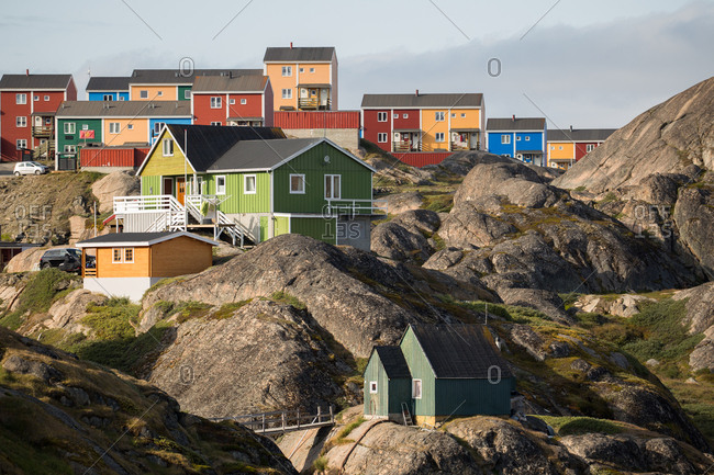 Colorful Scandinavian Architecture of Sisimiut, Greenland, built on rock and tundra terrain.