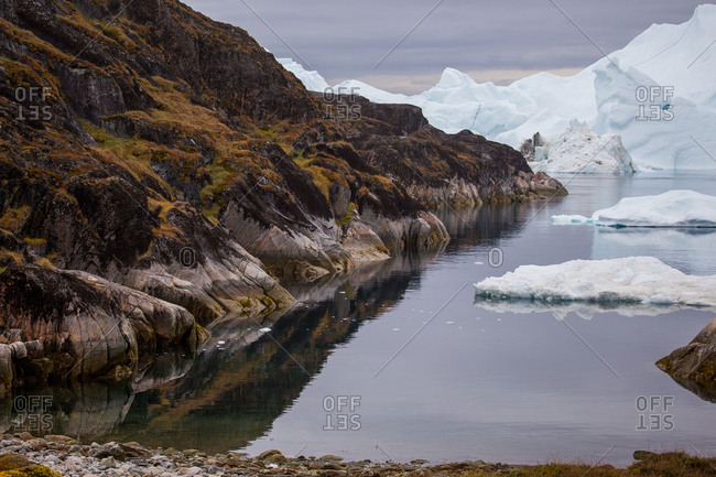 Landscape of tundra, rock, and icebergs in Ilulissat, Greenland