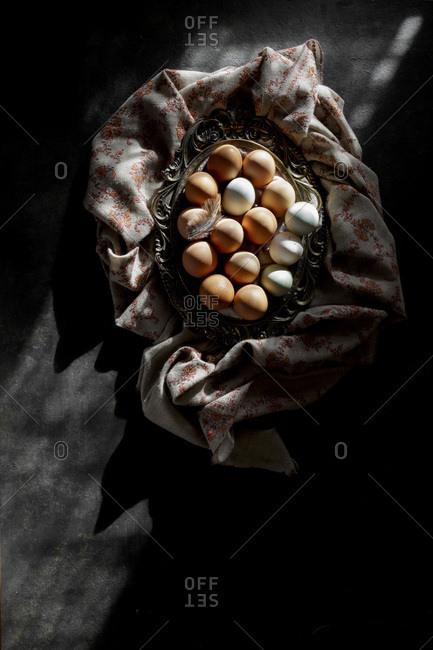 Eggs in a basket on a dark background
