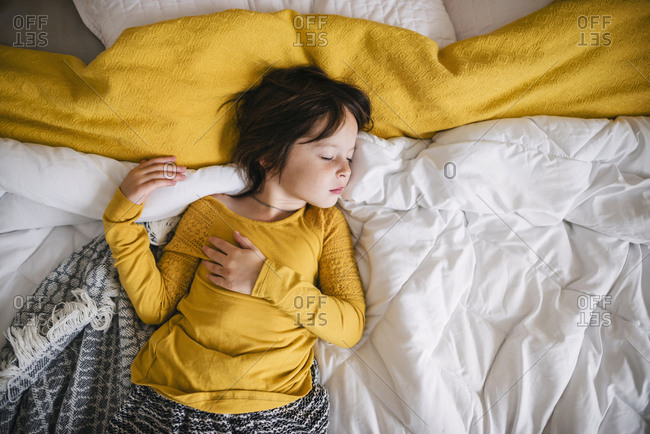 Young girl taking a nap