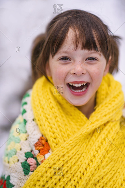 Portrait of a young girl wrapped in a blanket
