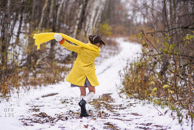 Young girl walking on winter trail