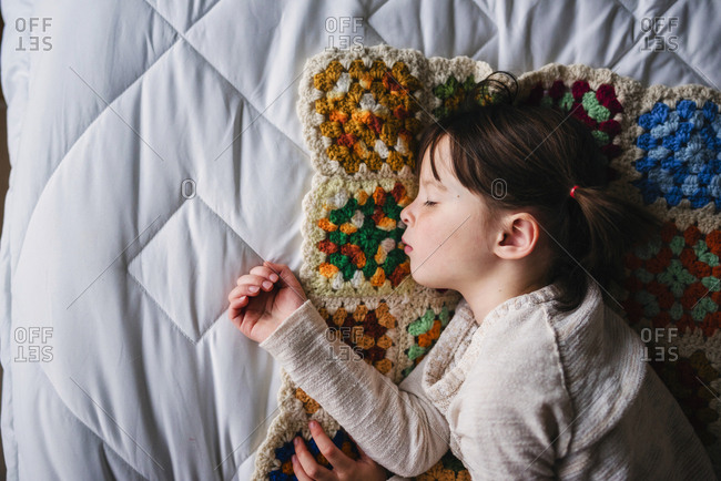 Young girl sleeping on bed