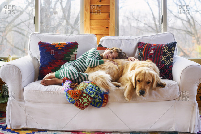 Young boy and dog napping on the couch