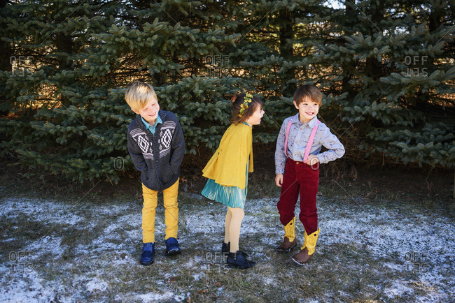 Two young boys and a girl dressed up for outdoor portrait