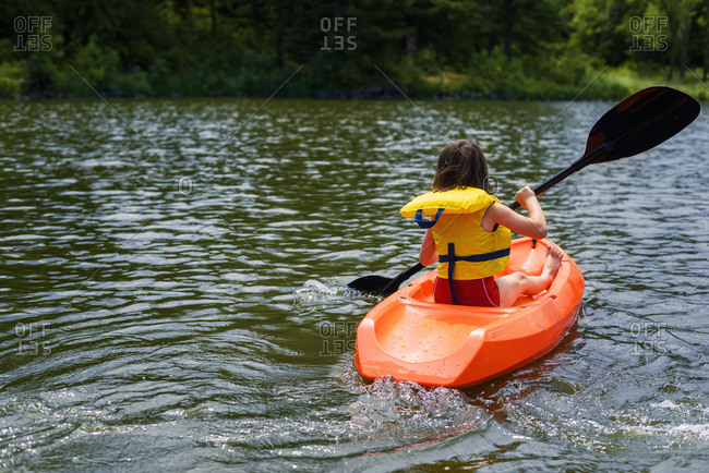 Young child kayaking