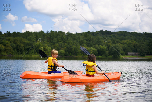 Two children kayaking together