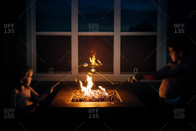 Boys roasting marshmallows
