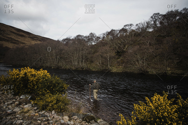 A fly fisherman enjoying the solitude on a river near Bettyhill, Scotland