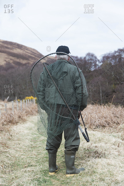 Bettyhill, Scotland - April 22, 2017: Rear view of a fisherman near Bettyhill, Scotland