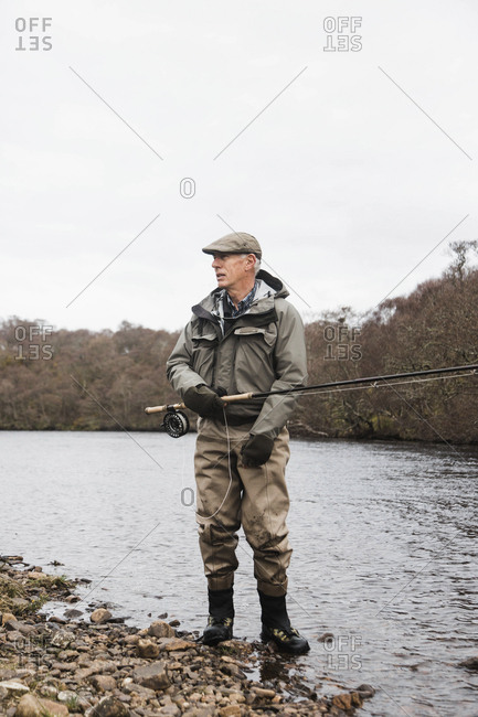 Bettyhill, Scotland - April 22, 2017: Portrait of a fisherman on the edge of a river near Bettyhill, Scotland