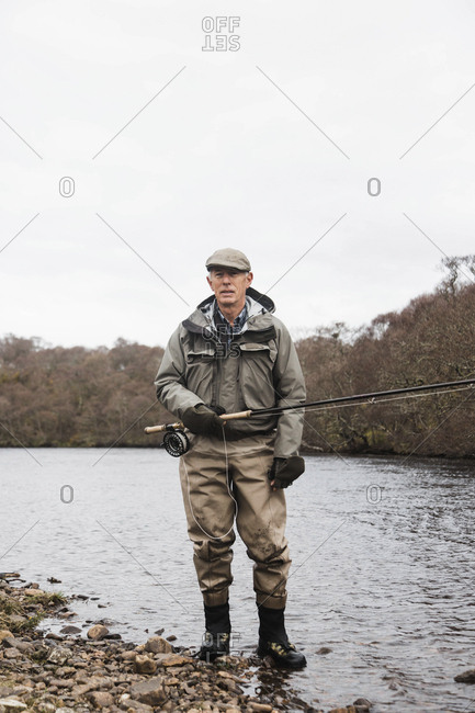 Bettyhill, Scotland - April 22, 2017: Portrait of a fisherman on the riverbank near Bettyhill, Scotland