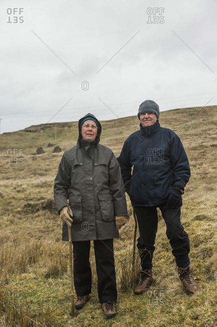 Scotland, United Kingdom - April 23, 2017: A couple enjoy a hike in a small village in northern Scotland